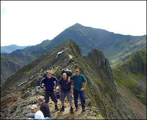 Sam from Barmouth (now Tunbridge Wells), Larry (USA) and JG (South Wales) on top of Crib Goch, Snowdon