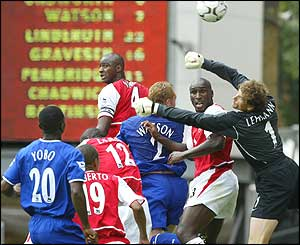 Lehmann punches the ball clear for Arsenal in a dramatic season curtain-raiser