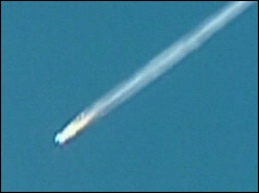 Shuttle falls to earth in flames