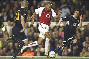 Thierry Henry evades Leeds' defence with ease