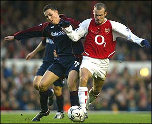Middlesbrough's Stewart Downing challenges Freddie Ljungberg, who scores Arsenal's fourth goal