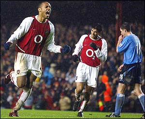 Henry celebrates his curling shot past David James that clinches the victory