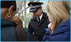 Policeman talks to students in a truancy sweep