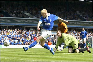Mikael Forssell waltzes through the Wolves defence to make it 1-1