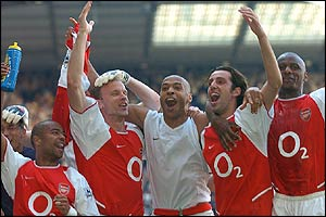 Arsenal celebrate at White Hart Lane