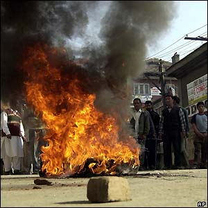 Tyres were set alight during protests in Srinagar
