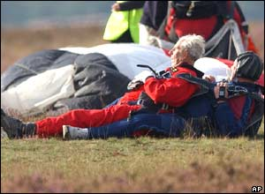 Ray Sherriff, a blind veteran, lies on top of his co-jumper after a tandem jump