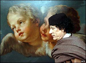 Gaddafi walks past a painting at EU HQ on his way to meet EU leaders