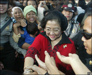Megawati Sukarnoputri  meets voters outside a polling station in Jakarta