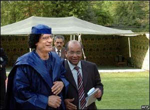 Col Gaddafi in front of a bedouin tent pitched in Brussels
