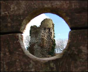 A picture of Llantrisant Castle, taken through the 600-year-old stocks near by (Stuart Osmundsen).