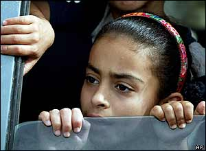 An Iraqi girl peers out of a car as she waits for the opening of the checkpoint leading into Falluja