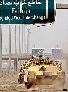 American tanks reposition along the highway linking Baghdad to Falluja