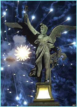 More fireworks explode over the statue of an angel on one of Prague's bridges  in the Czech Republic.