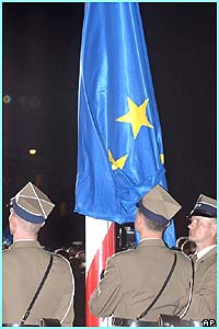 Soldiers from the Polish Army Guard of Honor raised the European Union flag seconds after midnight.