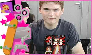 Jake Lloyd and his signed action figure