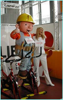 Tess snuggles up to Bob The Builder, who's helping to promote Sport Relief in schools