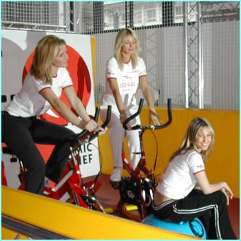 Rachel takes it easy while TV presenters Gabby Logan and Tess Daly try out the exercise bikes