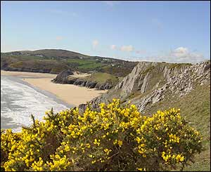 The Gower Coast from Pennard Cliffs overlooking Three Cliffs Bay, sent by Neil Lewis from the USA.