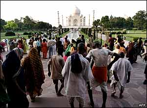 Indians and tourists visit the Taj Mahal on 26 September