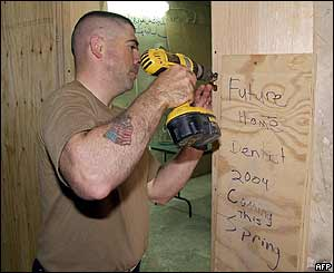 Handout photo from US military shows soldier working on the construction of a dental clinic inside Abu Ghraib