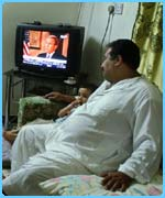 Iraqi man watches the president on TV