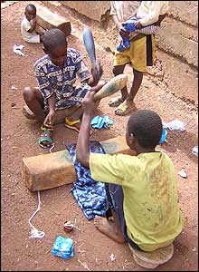 Children beating cloth