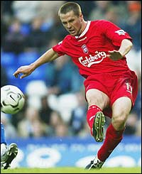 Michael Owen slots home the opener for Liverpool