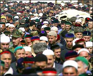 People gather on the streets of the Chechen village of Tsentoroi for the funeral
