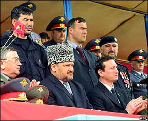 Ahmad Kadyrov (in hat) flanked by other top officials including regional commander Gen Valery Baranov (left)