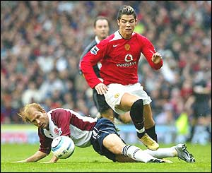 Cristiano Ronaldo is challenged by Middlesbrough's Gaizka Mendieta