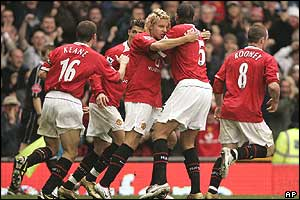 Alan Smith is congratulated on his equaliser