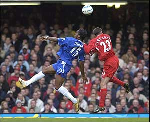 Didier Drogba and Jamie Carragher