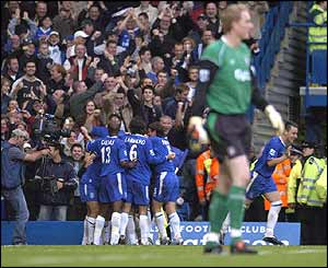 Joe Cole is mobbed by his Chelsea team-mates
