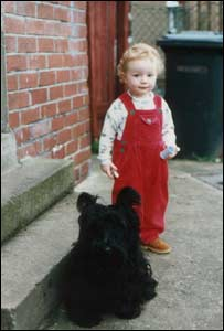 David Williams' daughter with the family's scottish terrier