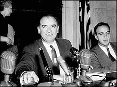 Senator Joe McCarthy in front of microphones