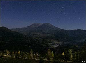 Mount St Helens is seen against a star-filled sky