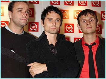Rockers Muse didn't look very happy even though they were named Best Live Act, let's hope they get more excited on stage