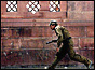 Police commando runs for cover (copyright: AP)