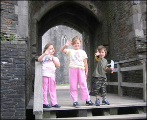 Andrew Williams' children Georgia, Grace and Lloyd, from Abergavenny, at Caerphilly Castle
