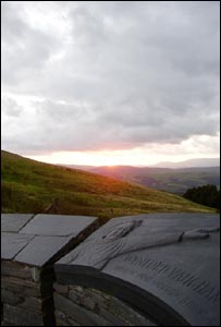 Sunset from the Wynford Vaughan Thomas memorial on the mountain road between Machynlleth and Llanidloes, from Royston Jones.