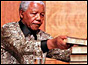 Nelson Mandela with the TRC report
