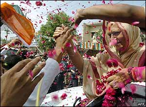 Supporters shower petals over Sonia Gandhi during the 2004 campaign