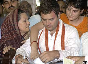 Rahul Gandhi submits candidacy papers with his mother Sonia, left, and sister Priyanka, right