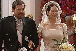 Bride Mary Donaldson walks down the aisle with her father John, 14 May 2004