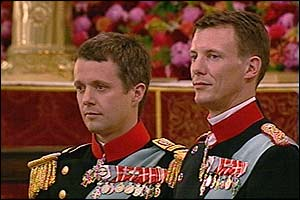 Danish Crown Prince Frederik stands with his brother Prince Joachim his best man