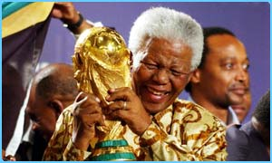 Former South Africa president Nelson Mandela with the World Cup trophy