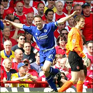 Paul Dickov celebrates his opening goal at Highbury