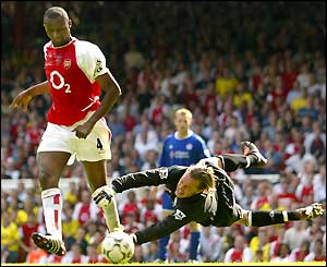 Patrick Vieira goes past Ian Walker to score