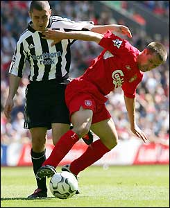 Michael Owen holds off Newcastle's Andrew Griffin
